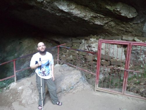 Tony inside Lumiang Cave. The wall to the right is stacked with coffins creating an entire wall. This large popular tourist cave is the starting point for the Cave Connection tour.
