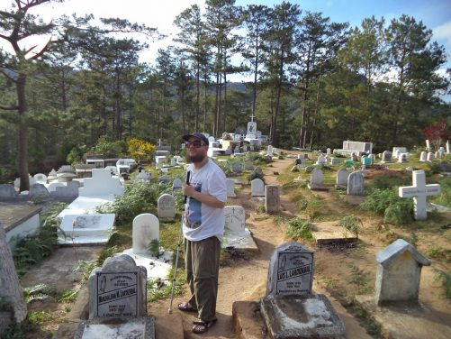 The public cemetery at Echo Valley. Tony amongst grave stones.