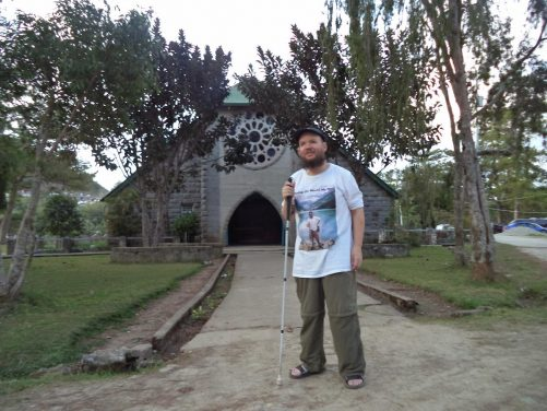 Tony in front of the Church of St. Mary the Virgin, located at the entrance to Echo Valley. It's the main Episcopalian church in Sagada.