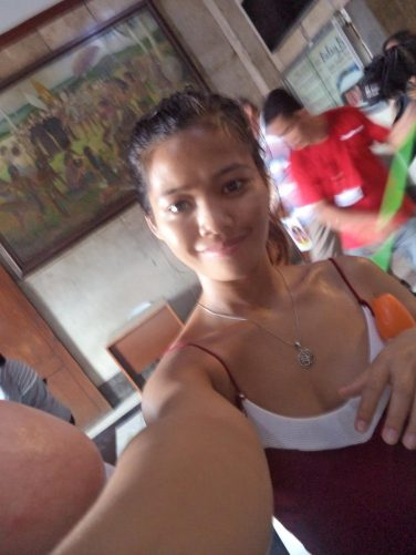 Filipino girl named Marybel taking a selfie inside the entrance to the Basilica of Santo Niño. Tony met her in a hostel in Cebu City.