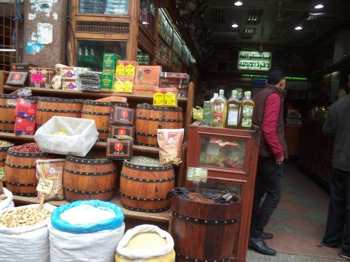 Outside a shop with sacks and barrels containing foodstuffs in Khan al-Khalili bazaar.