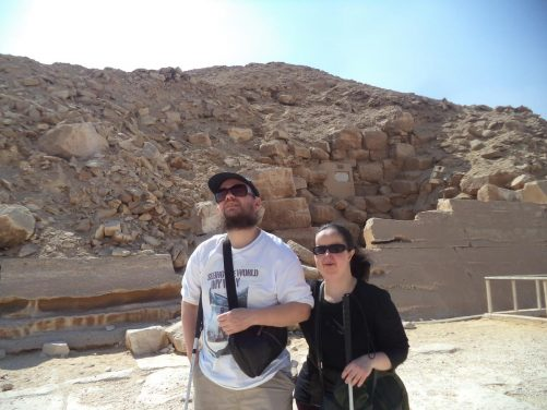 Tony and Tatiana outside Unas Pyramid. This pyramid was built during the 5th Dynasty (circa 2498 – 2345 BC) for the Egyptian pharaoh Unas, the ninth and final king of that dynasty. The pyramid's outside surface was originally smooth, but is now ruined. It is 43 metres in height and 57.7 metres along the four sides of its base.