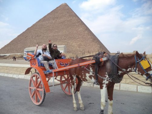 Tatiana and Tony in the horse-drawn carriage in front of the Great Pyramid of Giza.