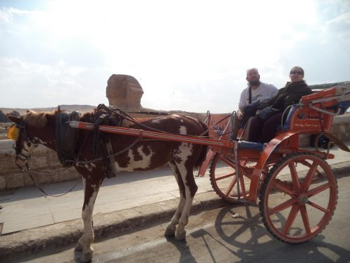 Tony and Tatiana in the horse-drawn carriage with the Great Sphinx alongside.