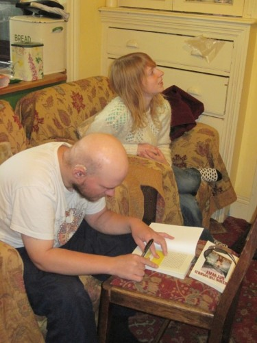 Tony and Lucy. Tony signing a copy of his book. Hartlepool.