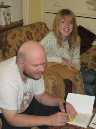 Tony with Lucy who he met in Mali. Tony signing a copy of his book. Hartlepool.