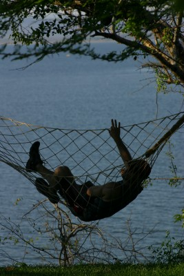 A man in a hammock at The Clubhouse