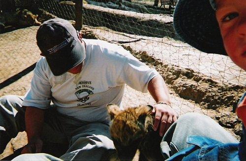 Tony stroking a hyena