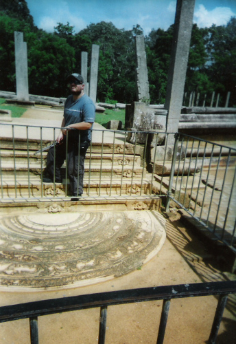 Tony beside a mosaic at Anuradhapura