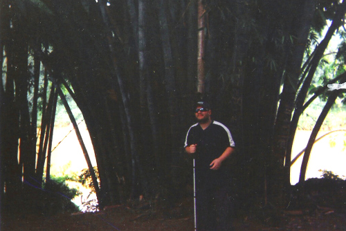 Tony stood by a large bamboo tree, Peradeniya Botanical Gardens, Kandy