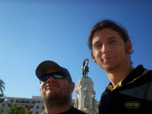 Tony and Will in front of a statue in Plaza Nueva