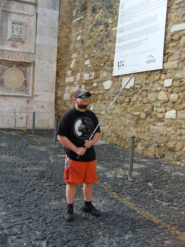 Tony in front of the castle wall