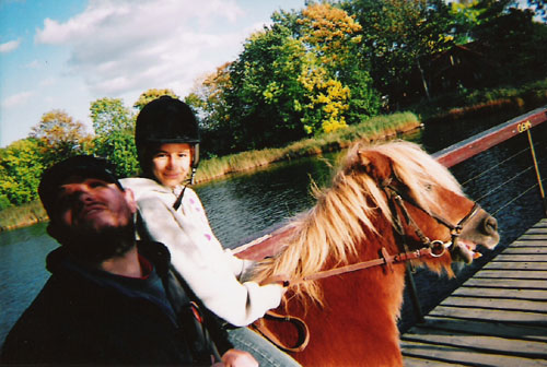 Girl on a horse and Tony. Christiania
