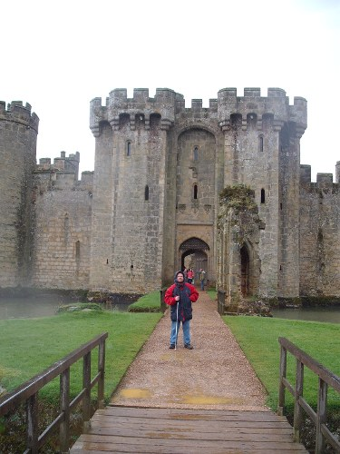 Tony on the drawbridge at Bodium Castle, East Sussex