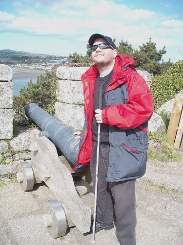 Tony stood by a canon on St. Michael's Mount, Cornwall