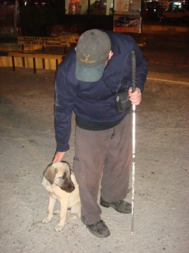 Tony patting Turkish dog in Göreme after putting Joe on a bus, evening of 23rd September 2009