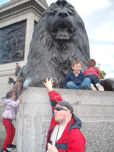Tony feeling the Lions, Trafalgar Square, London