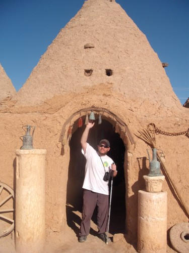 Tony outside a hut at Harran, Sanliurfa