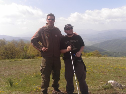 Tony and Petar on a grassy hillside near Krusevo city. It is known locally as Meckin Kamen (Bear's Rock).