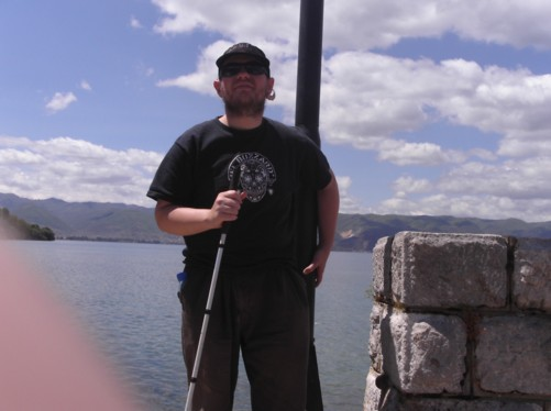 Tony at St. Naum monastery with a view of Lake Ohrid behind him.