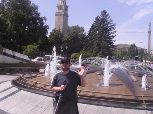 Tony standing in front of a fountain near the clock tower.