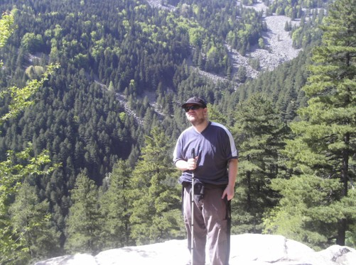 Tony with pleasant view of pine forest behind.