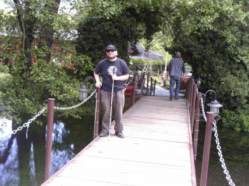Tony on a bridge over the life-giving springs of the Crn Drin, which flows into Lake Ohrid.