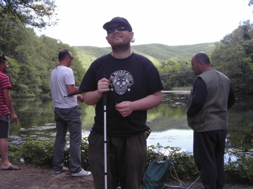 Tony with fishermen behind.