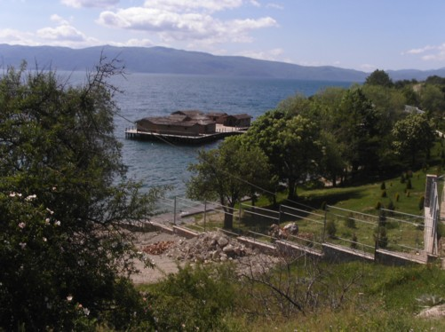 View of reconstructed prehistoric houses on the shore of Lake Ohrid, known as the Bay of the Bones.