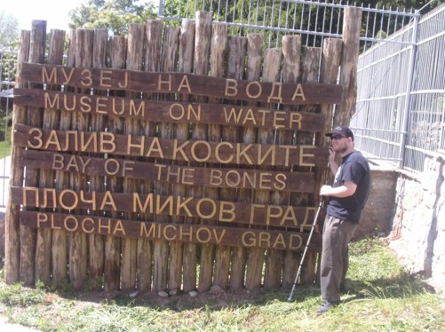 Tony by a sign for the Museum on Water, Bay of the Bones.