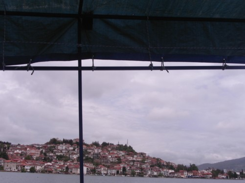View of Ohrid town from a small boat on Lake Ohrid.