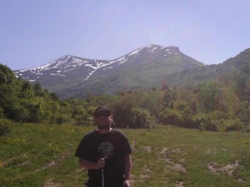 Tony with a view of Mt. Baba in the distance. Snow on Pelister Peak.