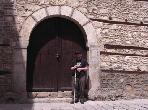Tony by a large doorway. This is the lower gate of the ancient fortified city of Ohrid