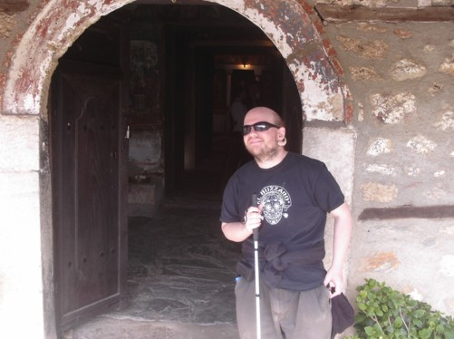Tony at the entrance to the late 13th-century Saint Bogorodica Perivleptos church.