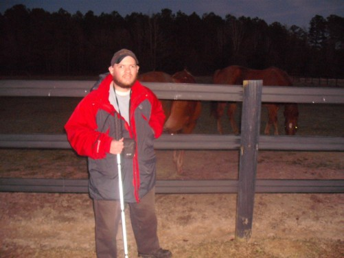 Tony and horses. Farm near the town of Lumberton, North Carolina, USA.