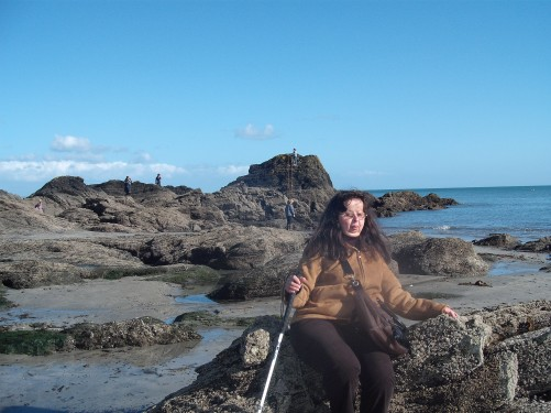 Tatiana on rock love seat, Looe beach.