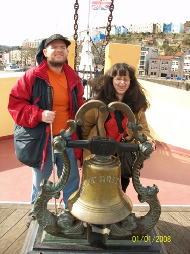 Tony and Tatiana and ship's bell, SS Great Britain.