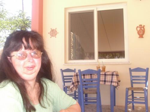 Tatiana in a taverna opposite the monastery.