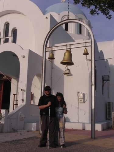 Tony and Tatiana by bells outside Agioi Anargyroi Church.