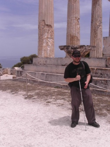 Tony at Athia Temple. Stone columns behind.