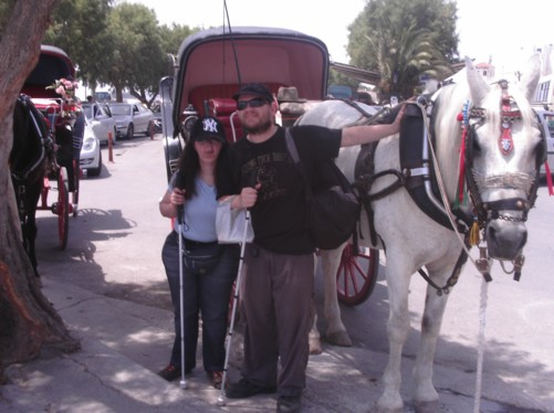 Tatiana and Tony next to a horse and carriage in Aegina harbour.