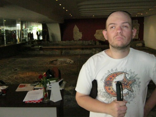 Tony inside Cultural Center Thrakart. Roman mosaics visible behind him.