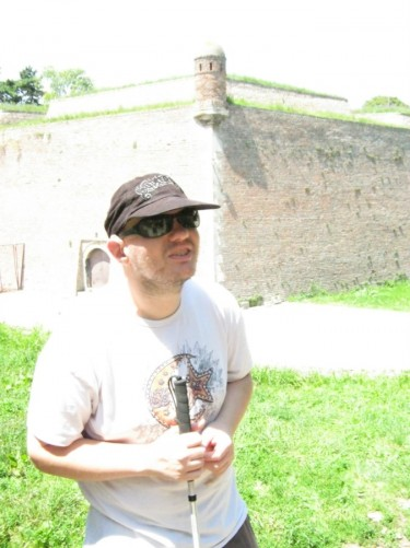 Tony, in the background is a high stone wall, part of Kalemegdan Fortress.