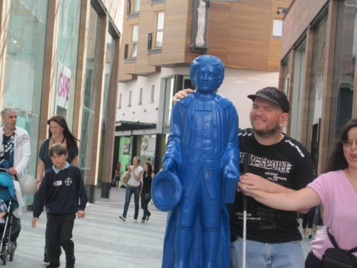 Tony and Tatiana by famous Blue Boy statue on Princesshay in Exeter city centre.
