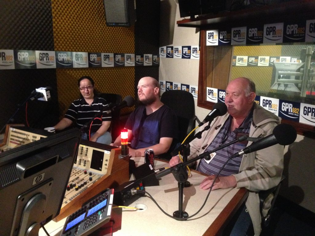 Tatiana, Tony and interviewer Steve Collins in the studio, 6PR, Perth.