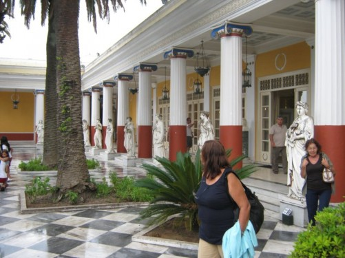 Porticoed courtyard with a row of statues.
