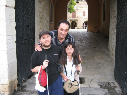 Tony and Tatiana with a local man from Corfu Town who showed them around. They are in front of a large doorway, one of the entrances to the Old Fortress.