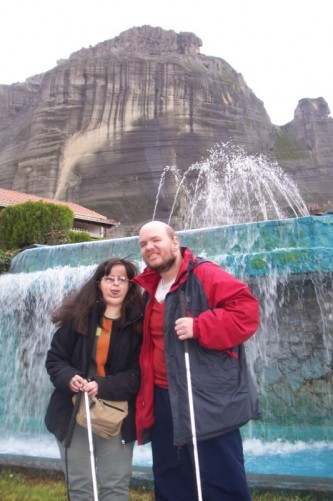 Tony and Tatiana in front of a fountain in Kalampaka village square.