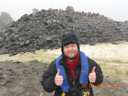Tony on Half Moon Island. Behind is a rocky outcrop where the penguins make their nests.
