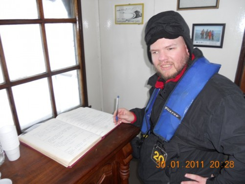 Tony about to sign the guest book. Camara scientific station.